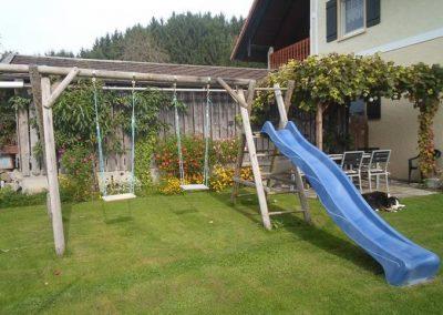 Ferienhof Bock in Amtzell | Gartenlaube mit Spielplatz